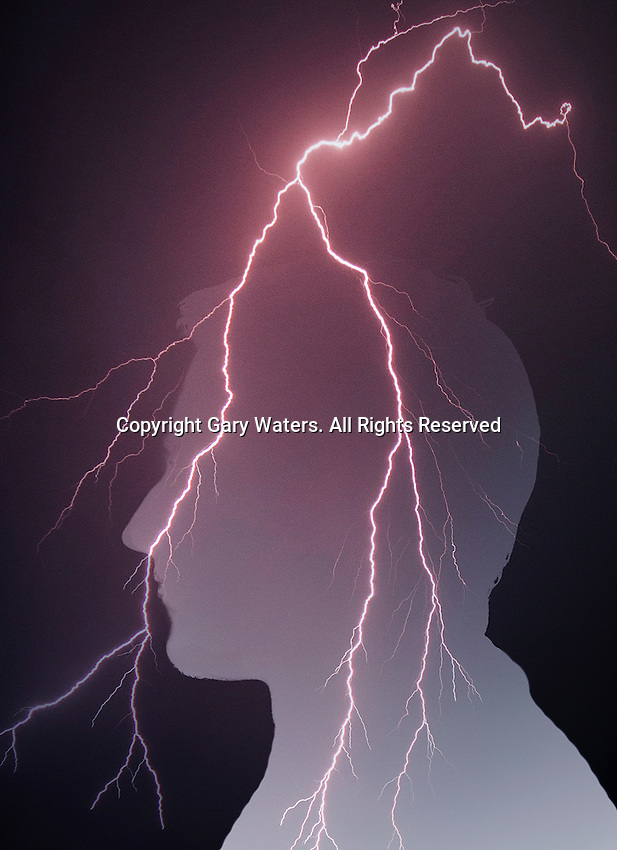 Lightning over silhouette of a head ExclusiveImage