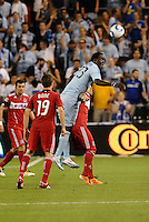 Kei Kamara (blue) Sporting KC...Sporting KC were held to a scoreless tie with Chicago Fire in the inauguarl game at LIVESTRONG Sporting Park, Kansas City, Kansas.