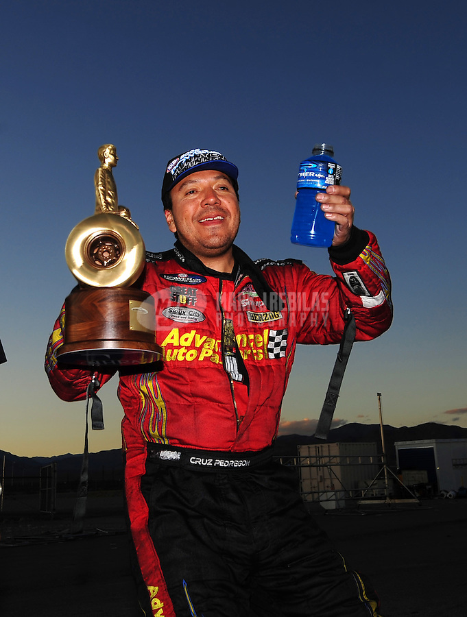 Nov. 2, 2008; Las Vegas, NV, USA: NHRA funny car driver Cruz Pedregon after winning the Las Vegas Nationals at The Strip in Las Vegas. Mandatory Credit: Mark J. Rebilas-