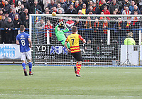 Jack Leighfield saves the shot of Blair Spittal in the SPFL Ladbrokes Championship football match between Queen of the South and Partick Thistle at Palmerston Park, Dumfries on  4.5.19.