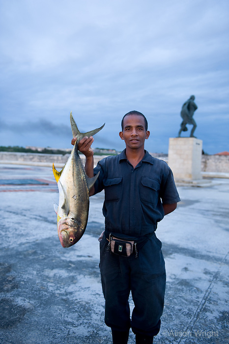 Man with fish that he caught, Frank Rivero
