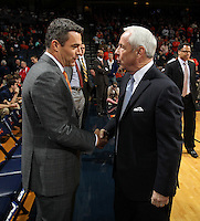Virginia head coach Tony Bennett, left, shakes hands with North Carolina head coach Roy Williams during an NCAA basketball game Monday Jan. 20, 2014 in Charlottesville, VA. Virginia defeated North Carolina 76-61.