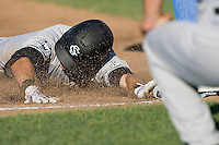 South Carolina 2B Scott Wingo slides head first into third in Game One of the NCAA Division One Men's College World Series Finals on June 28th, 2010 at Johnny Rosenblatt Stadium in Omaha, Nebraska.  (Photo by Andrew Woolley / Four Seam Images)