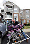 William Massart loads his daughter Sandra Massart, 10, into a vehicle outside the family's apartment in Durham, NC, USA, on Tuesday, Feb. 14, 2012.  Sandra Massart is being treated for MLD, a degenerative condition.  Photo by Ted Richardson