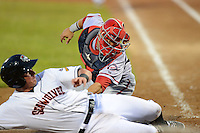 Harrisburg Senators catcher Sandy Leon #40 tags out James McCann sliding into home during a game against the Erie Seawolves on July 2, 2013 at Jerry Uht Park in Erie, Pennsylvania.  Erie defeated Harrisburg 2-1.  (Mike Janes/Four Seam Images)