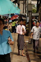 People wearing  THANAKHA  traditional cosmetic in <br /> Yangon . Myanmar, on a sunny day of July 2017