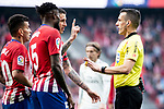 Thomas Teye and Angel Martin Correa of Atletico de Madrid protesting to referee during La Liga match between Atletico de Madrid and Real Madrid at Wanda Metropolitano in Madrid Spain. February 09, 2018. (ALTERPHOTOS/Borja B.Hojas)