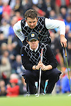Graeme McDowell leans over Rory McIlroy as he line up his putt on the 17th on day two Foursomes matches  on saturday afternoon at the 2010 Ryder Cup at the Celtic Manor twenty ten course, Newport Wales, 2/10/2010.Picture Fran Caffrey/www.golffile.ie.
