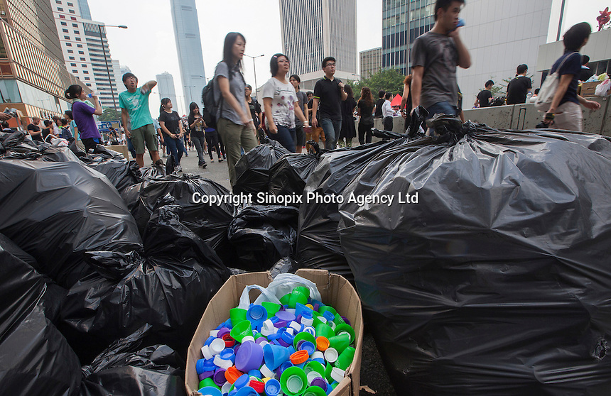 Plastic bottle tops are seen seperated for for recycling by students on day three of the mass civil disobedience campaign Occupy Central, Hong Kong, China, 30 September 2014.