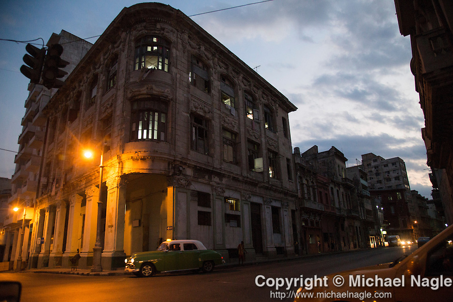 HAVANA, CUBA -- MARCH 23, 2015:  A taxi drives at dusk in Havana, Cuba on March 23, 2015. Photograph by Michael Nagle