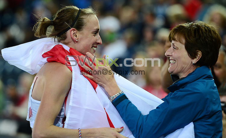Picture by Alex Broadway/SWpix.com - 29/07/2014 - 2014 Glasgow Commonwealth Games, Day 6 - Athletics - Hampden Park, Glasgow, Scotland - Laura Weightman of England celebrates her Silver medal in the Women's 1500m Final with her Mum.