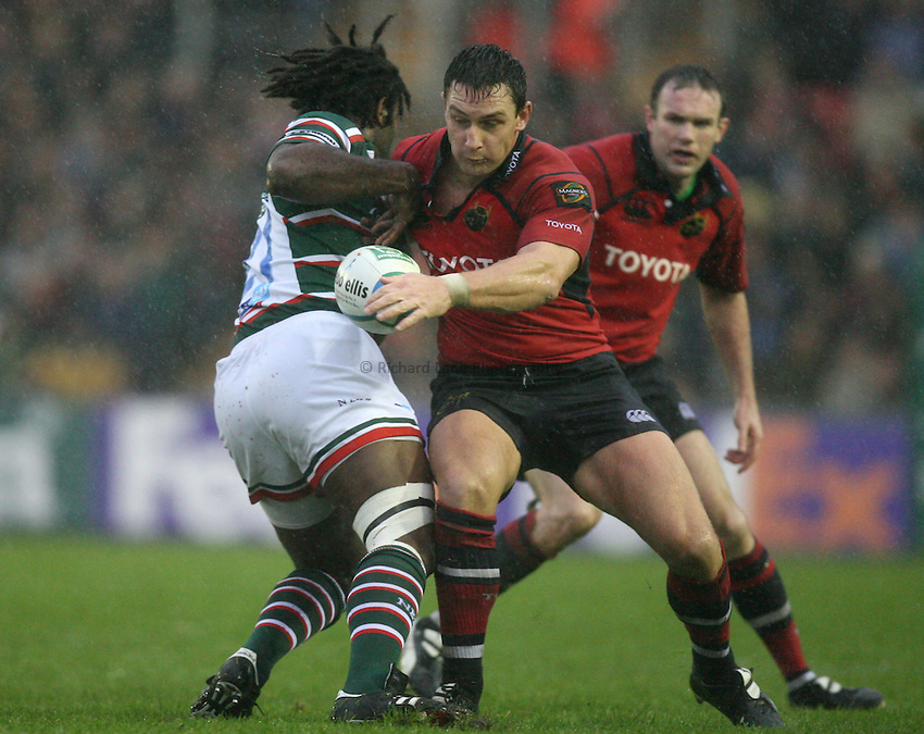 Photo: Rich Eaton...Leicester Tigers v Munster Rugby. Heineken Cup. 22/10/2006. David Wallace (rt) of Munster steals ball from Seru Rabeni of Tigers.