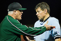 Charlotte 49ers head coach Loren Hibbs #49 argues a call with home plate umpire Gary Swanson during the game against the Wake Forest Demon Deacons at Gene Hooks Field on March 22, 2011 in Winston-Salem, North Carolina.   Photo by Brian Westerholt / Four Seam Images