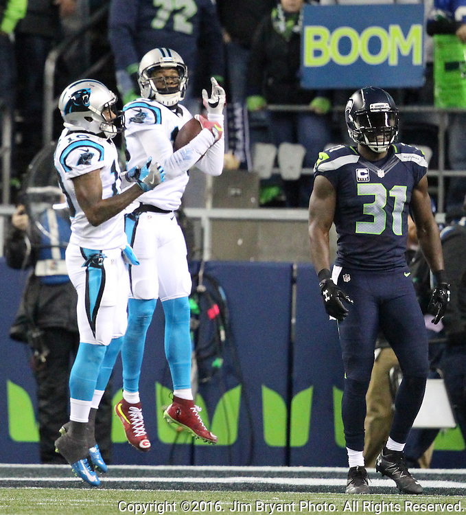 Carolina Panthers wide receiver Ted Ginn (19) celebrates with  wide receiver Corey Brown (10) after catching a 55-yard touchdown pass from quarterback Kam Newton in the second quarter at CenturyLink Field in Seattle, Washington on December 4, 2016.  Defending on the play was Seattle Seahawks strong safety Kam Chancellor (31). Seahawks beat the Panthers 40-7.  ©2016. Jim Bryant photo. All Rights Reserved.
