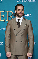 "HOLLYWOOD, CA - FEBRUARY 13: Richard Rankin, at the Premiere Of Starz's ""Outlander"" Season 5 at HHollywood Palladium in Hollywood California on February 13, 2020. Credit: Faye Sadou/MediaPunch"