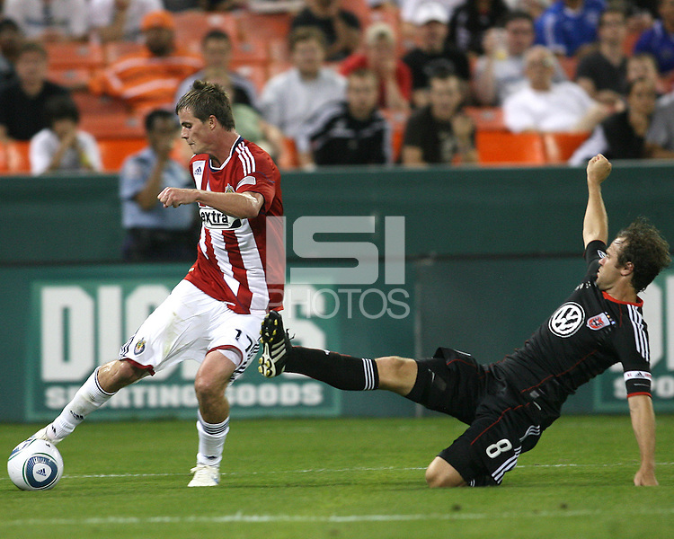 Carey Talley #8 of D.C. United slides into Justin Braun #17 of Chivas USA during an MLS match at RFK Stadium, on May 29 2010 in Washington DC. United won 3-2.
