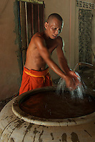 Working Monk washing his hands at the Monastery near Angkor Wat, Siem Rep Cambodia
