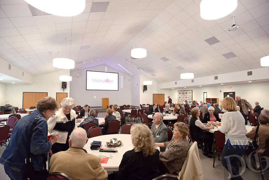 NWA Democrat-Gazette/BEN GOFF @NWABENGOFF<br /> Church members and guests have refreshments in the new fellowship hall after service on Sunday Nov. 8, 2015 at Bella Vista Lutheran Church. The church held a dedication ceremony Sunday for their recently completed 10,500 square foot expansion, which includes the new fellowship hall upstairs and classroom space downstairs. The project also involved the renovation of 6,500 square feet of existing space, making more room for offices and the church's food pantry.