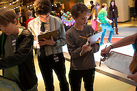 NEW YORK - FEB 1: Students from various schools in Manhattan interact with exhibits at The National Museum of Mathematics--including the LED lights of the Math Square--on Friday, February 1, 2013, in New York City. (Photo by Landon Nordeman)