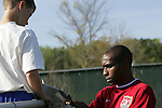 Eddie Pope (r) signs an autograph for a young fan on Monday, April 10th, 2006 at SAS Stadium in Cary, North Carolina. The United States Men's National Team practiced the day before playing an international friendly against Jamaica.