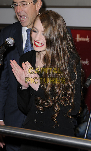 ELIZABETH JAGGER .open Harrods Winter Sale, knightsbridge, london, England 27th December 2010.lizzie lizzy half length  black dress coat jacket  hands clapping smiling red lipstick funny .CAP/CAN.©Can Nguyen/Capital Pictures.