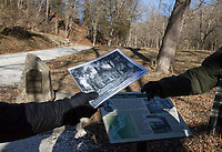 NWA Democrat-Gazette/CHARLIE KAIJO Tour group members pass a picture of the Van Winkle home in front of the home's site during a hike on Monday, January 1, 2018 at the Van Winkle sawmill trail in Rogers.<br />