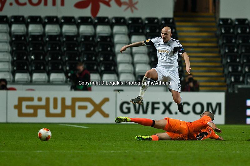 Thursday 28 November  2013  Pictured: Jonjo Shelvey jumps to avoid Oriol Romeu's tackle<br /> Re:UEFA Europa League, Swansea City FC vs Valencia CF  at the Liberty Staduim Swansea