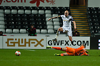 Thursday 28 November  2013  Pictured: Jonjo Shelvey jumps to avoid Oriol Romeu's tackle<br /> Re:UEFA Europa League, Swansea City FC vs Valencia CF  at the Liberty Staduim Swansea