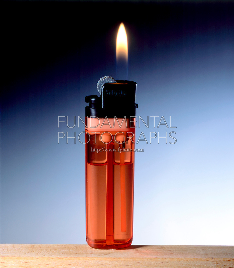 BUTANE LIGHTER With Flame<br /> (2 of 2)<br /> Red lighter is lit after the spark is ignited by flammable gas in the chamber.