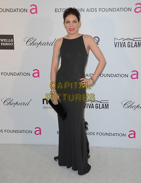 Skylar Grey.The 21st Annual Elton John AIDS Foundation Academy Awards Viewing Party held at The City of West Hollywood Park in West Hollywood, California, USA..February 24th, 2013.oscars full length dress black sleeveless clutch bag hand on hip.CAP/DVS.©DVS/Capital Pictures.