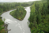 The Eagle River flows around an island before going under the tracks. The Alaska Railroad's Denali Star train runs between Anchorage and Fairbanks, with Denali one of the stops along the way.