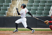 Tyler Frost (1) of the Kannapolis Intimidators follows through on his swing against the Lakewood BlueClaws at Kannapolis Intimidators Stadium on April 8, 2018 in Kannapolis, North Carolina.  The Intimidators defeated the BlueClaws 4-3 in game two of a double-header.  (Brian Westerholt/Four Seam Images)