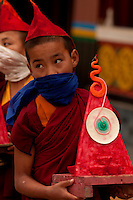 Buddhist monk carrying a wax art offering for the Losar ceremony,  Sikkim India