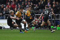 Northampton Saints George Pisi is tackled by Ospreys Jonathan Spratt. Liberty Stadium, Swansea, South Wales 12.01.14. Ospreys v Northampton Heineken Cup round 5 pool 1 - pIc credit Jeff Thomas photography