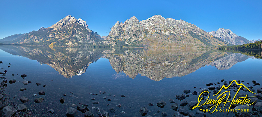 Jenny Lake Panorama, Grand Teton Mountain Reflections in the calm water of Jenny Lake in Grand Teton National Park.<br />