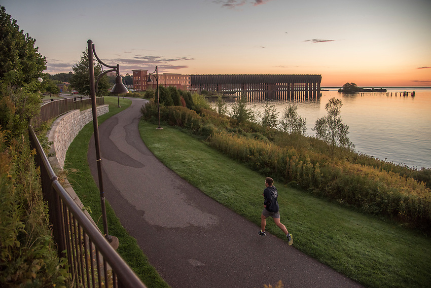 Lake Superior waterfront of downtown Marquette, Michigan at dawn.