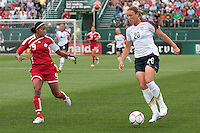 USWNT'S Abby Wambach (20) dribbles the ball downfield as Canada's Candace Chapman (9) defends. The U.S. Women's National Team defeated Canada 1-0 in a friendly match at Marina Auto Stadium in Rochester, NY on July 19, 2009. Abby Wambach of the USWNT scored her 100th career goal in the second half..