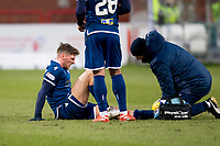 8th February 2020; Dens Park, Dundee, Scotland; Scottish Championship Football, Dundee versus Partick Thistle; Ross Callachan of Dundee gets treatment after being injured in a challenge