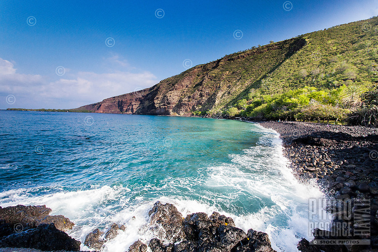 A wave crashing on the shore of Kealakekua Bay, Big Island.