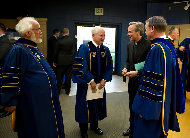 May 22, 2011; Rev. James McDonald, C.S.C, U.S. Secretary of Defense Robert Gates, Rev. John Jenkins, C.S.C. and Chairman of the Notre Dame Board of Trustees Richard Notebaert chat before the 2011 Commencement ceremony...Photo by Matt Cashore/University of Notre Dame