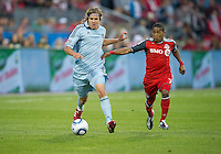 Sporting KC defender/midfielder Chance Myers #7 and Toronto FC forward Joao Plata #7 in action during an MLS game between Sporting Kansas City and the Toronto FC at BMO Field in Toronto on June 4, 2011..The game ended in a 0-0 draw...