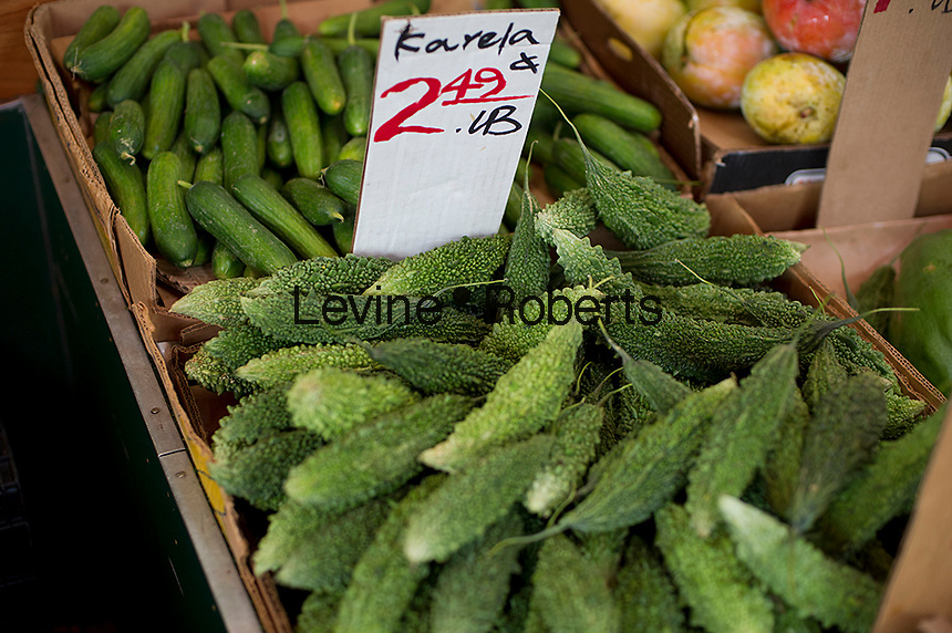 Karela for sale at a greengrocer in Richmond Hill in the New York borough of Queens on Sunday, August 5, 2012.  The neighborhood of Richmond Hill is a polyglot of ethnic cultures. It is home to Pakistanis, Indians, Guyanese and has a large Sikh population.  (© Frances M. Roberts)