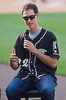 Joey Logano, driver of the #22 Ford Fusion for Team Penske, is interviewed on the field prior to the International League game between the Norfolk Tides and the Charlotte Knights at BB&T Ballpark on May 21, 2014 in Charlotte, North Carolina.  (Brian Westerholt/Four Seam Images)