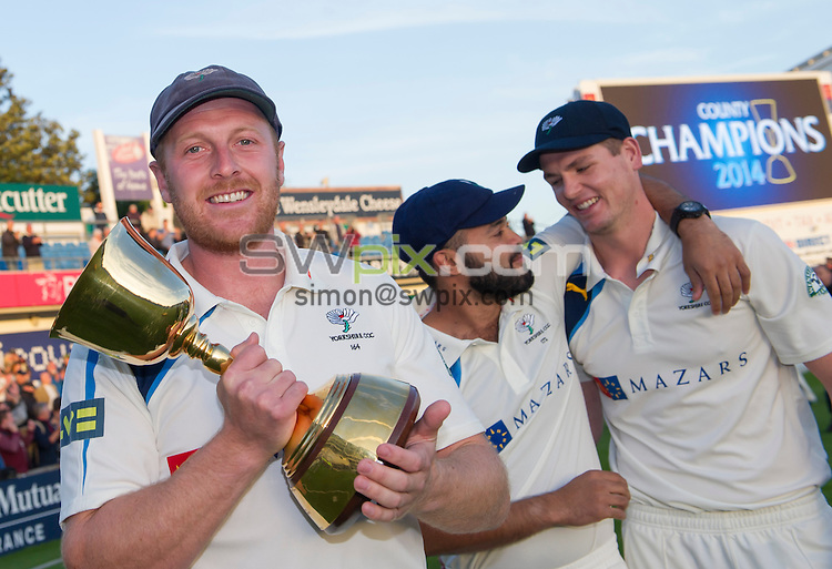 Picture by Allan McKenzie/SWpix.com - 26/09/2014 - Cricket - LV County Championship Div One - Yorkshire County Cricket Club v Somerset County Cricket Club - Headingley Cricket Ground, Leeds, England - Yorkshire's Andrew Gale proudley presents the County Championship trophy whilst Azeem rafiq and Alex Lees congratulate each other.