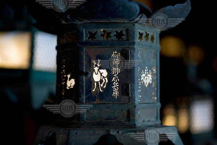 A lamp featuring an opaque deer design at the Kasuga Taisha Temple shrine at the Nara-Koen Park. The 1200 Sika deer that roam freely in the Nara Deer Park are revered and held in great esteem. /Felix Features