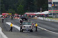 Aug. 6, 2011; Kent, WA, USA; NHRA safety safari cleans up oil left on the track during qualifying for the Northwest Nationals at Pacific Raceways. Mandatory Credit: Mark J. Rebilas-