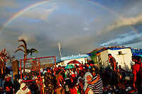 A rainbow appears above typhoon survivors desperate to catch a flight from the Tacloban airport November 15, 2013. The death toll from Typhoon Haiyan in the devastated Philippine coastal city of Tacloban was 4,000, a notice board at City Hall said on Friday, nearly double the nationwide toll provided by the government in Manila.