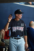 Wisconsin Timber Rattlers pitching coach Gary Lucas (25) calls the bullpen during the first game of a doubleheader against the Quad Cities River Bandits on August 19, 2015 at Modern Woodmen Park in Davenport, Iowa.  Quad Cities defeated Wisconsin 3-2.  (Mike Janes/Four Seam Images)