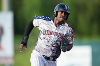 Micker Adolfo (27) of the Kannapolis Intimidators hustles towards third base against the Delmarva Shorebirds at Kannapolis Intimidators Stadium on June 30, 2017 in Kannapolis, North Carolina.  The Shorebirds defeated the Intimidators 6-4.  (Brian Westerholt/Four Seam Images)