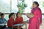 A teacher and students in class in Pida, a village in Nepal's Dhading District where the United Methodist Committee on Relief (UMCOR), a member of the ACT Alliance, is helping families to rebuild their lives in the wake of the 2015 earthquake that ravaged much of Nepal. Their classroom was built by UMCOR after the existing school building was severely damaged by the quake. Villagers have yet to construct the walls.